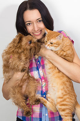 INOpets.com Anything for Pets Parents & Their Pets Woman holding a cat and a dog