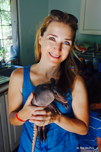 Dr. Ruth MacPete holding an armadillo