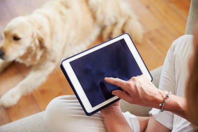 Woman on tablet with dog