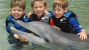 kids with a dolphin