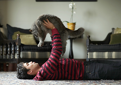 Guy holding is cat